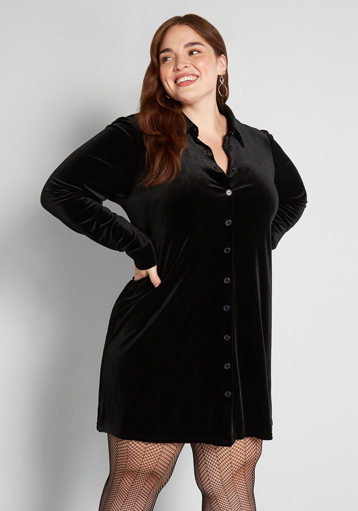 model wearing the sleeved black button-up dress