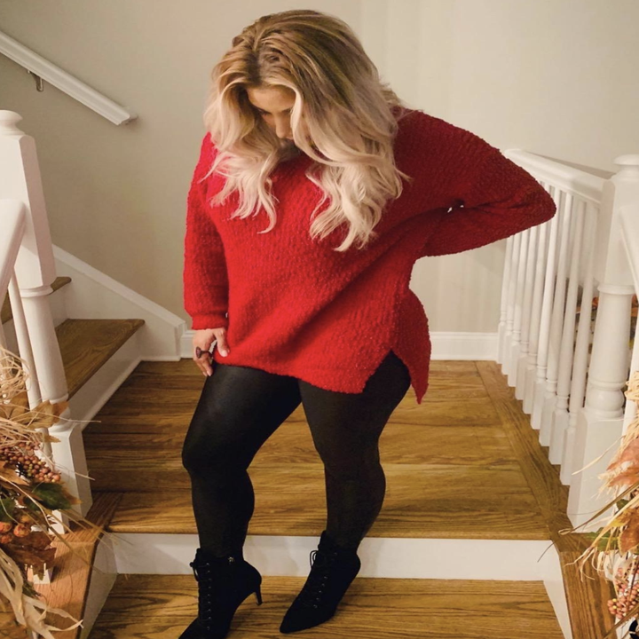 reviewer wearing the red sweater with side slit