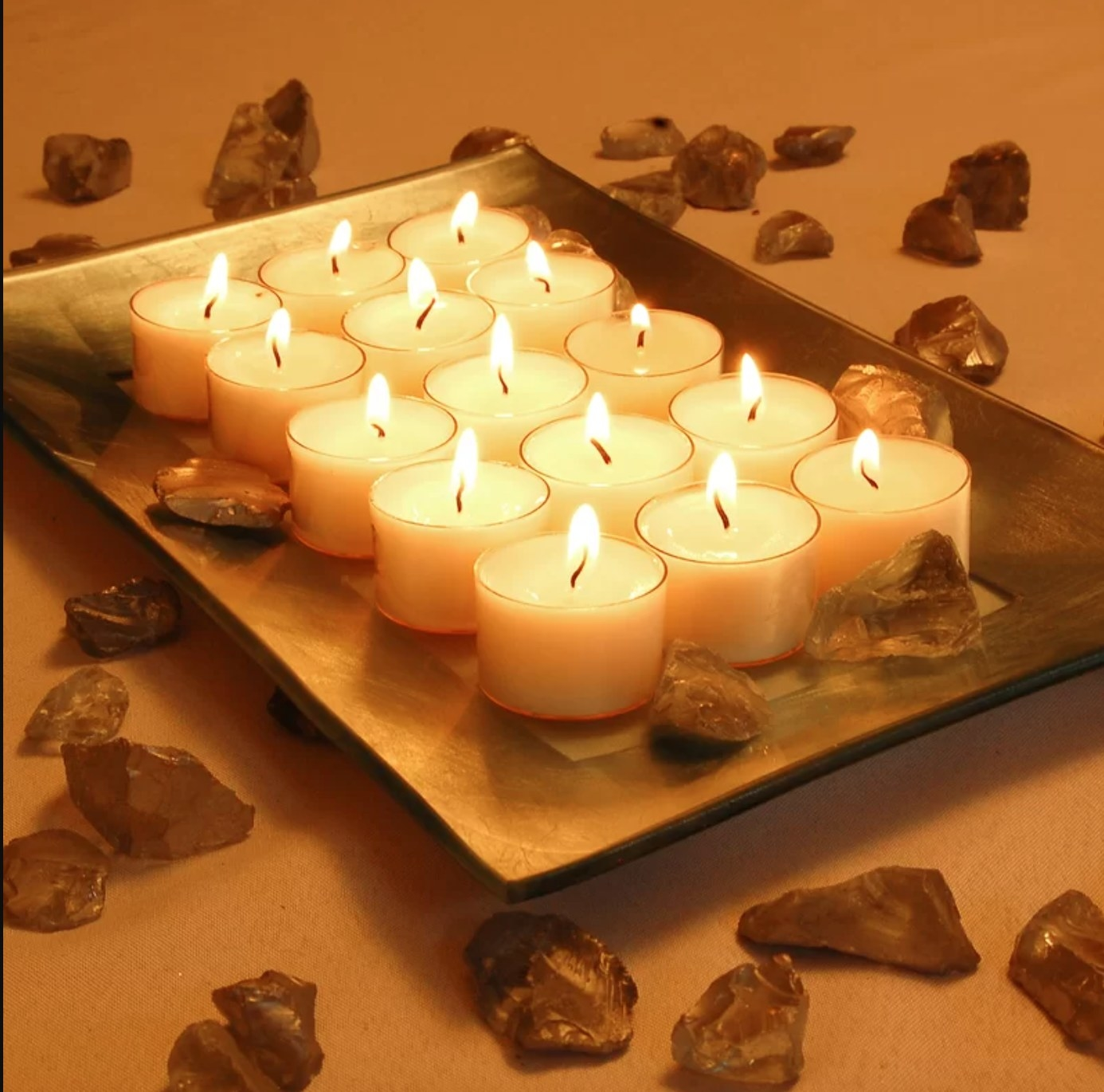 The set of 30 extended burn fall candles lit on a tray
