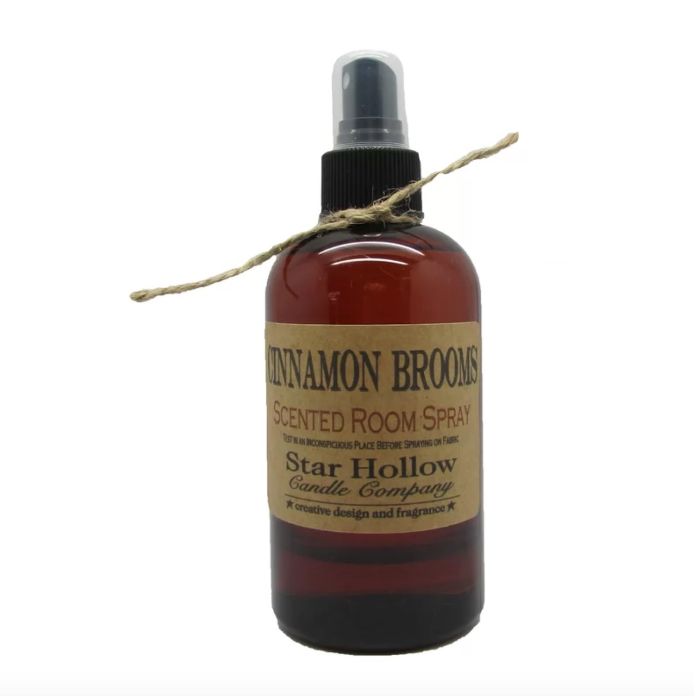 The cinnamon broom room spray in brown with twine decor