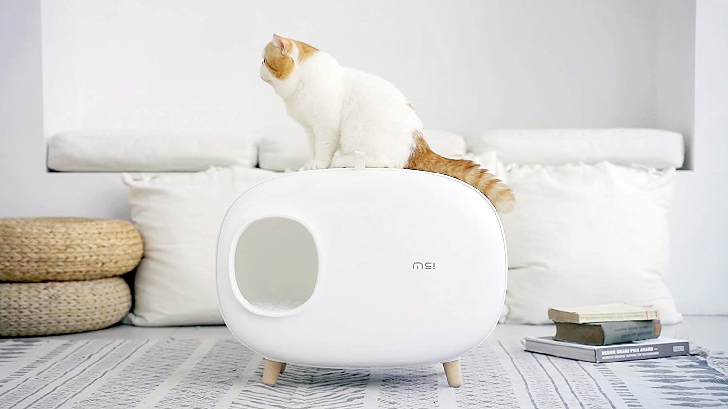 Minimalist covered litter box with round edges and mid-century-modern wooden legs