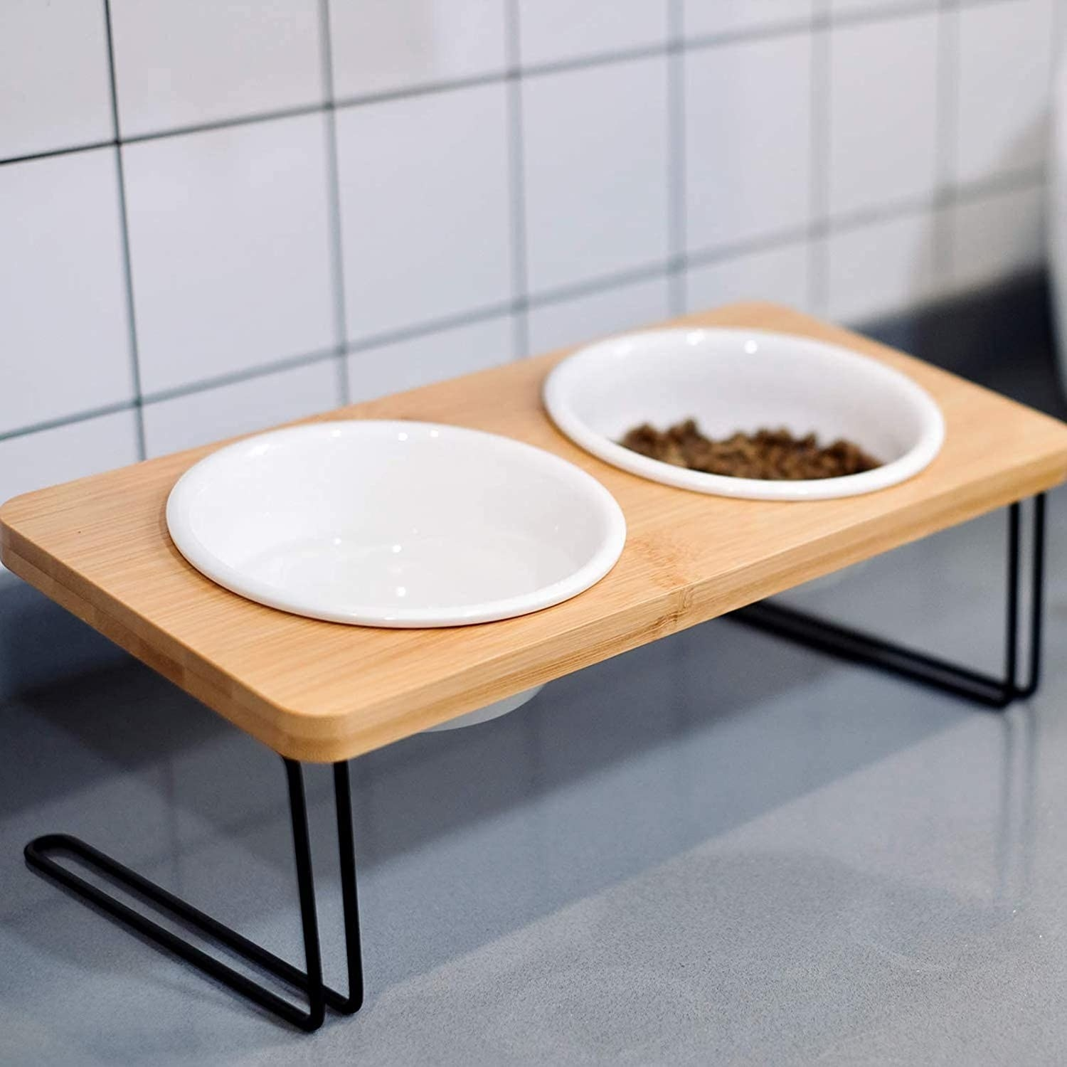 White bowls set inside natural wood table with black iron pipe legs