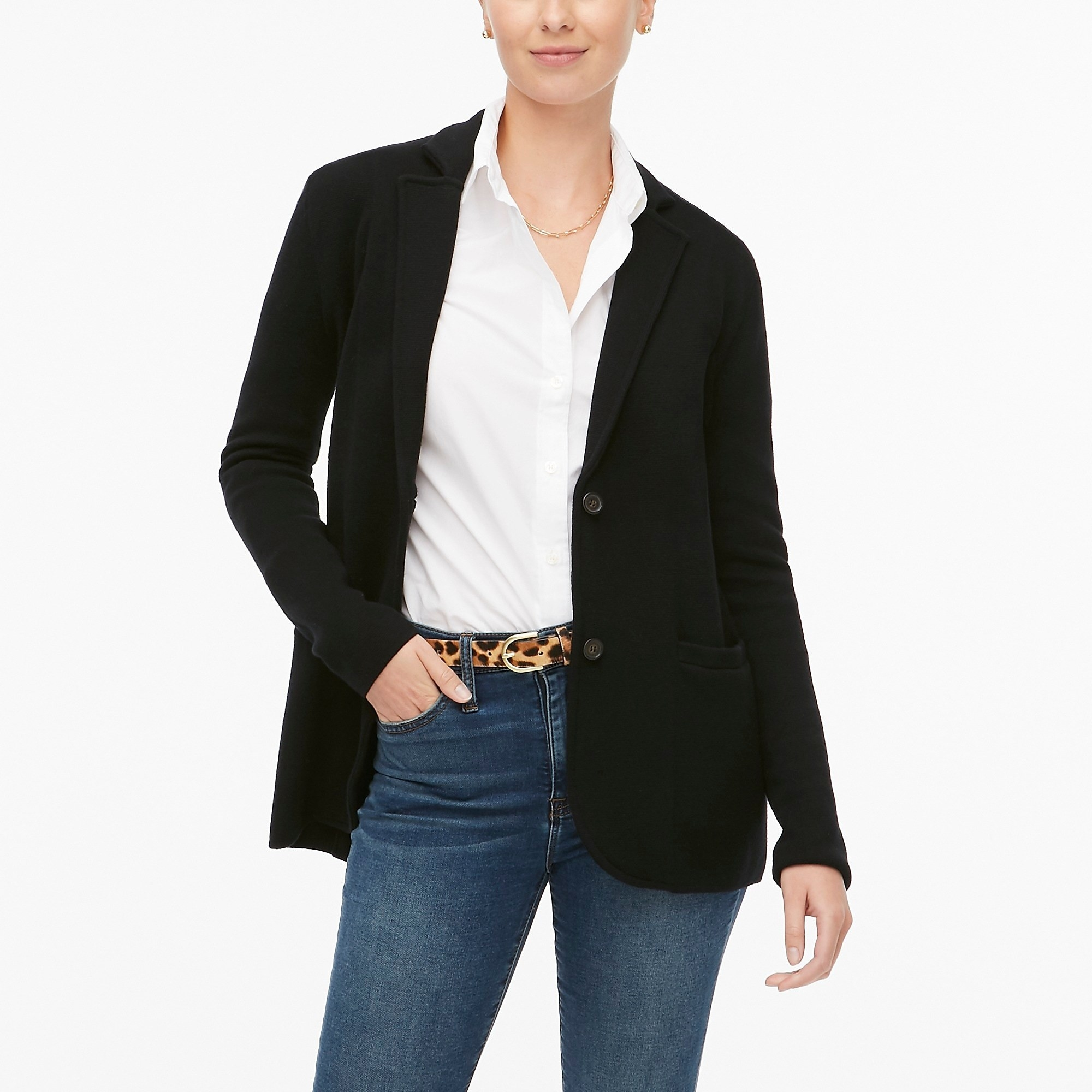 model wearing the black blazer with pockets and two buttons