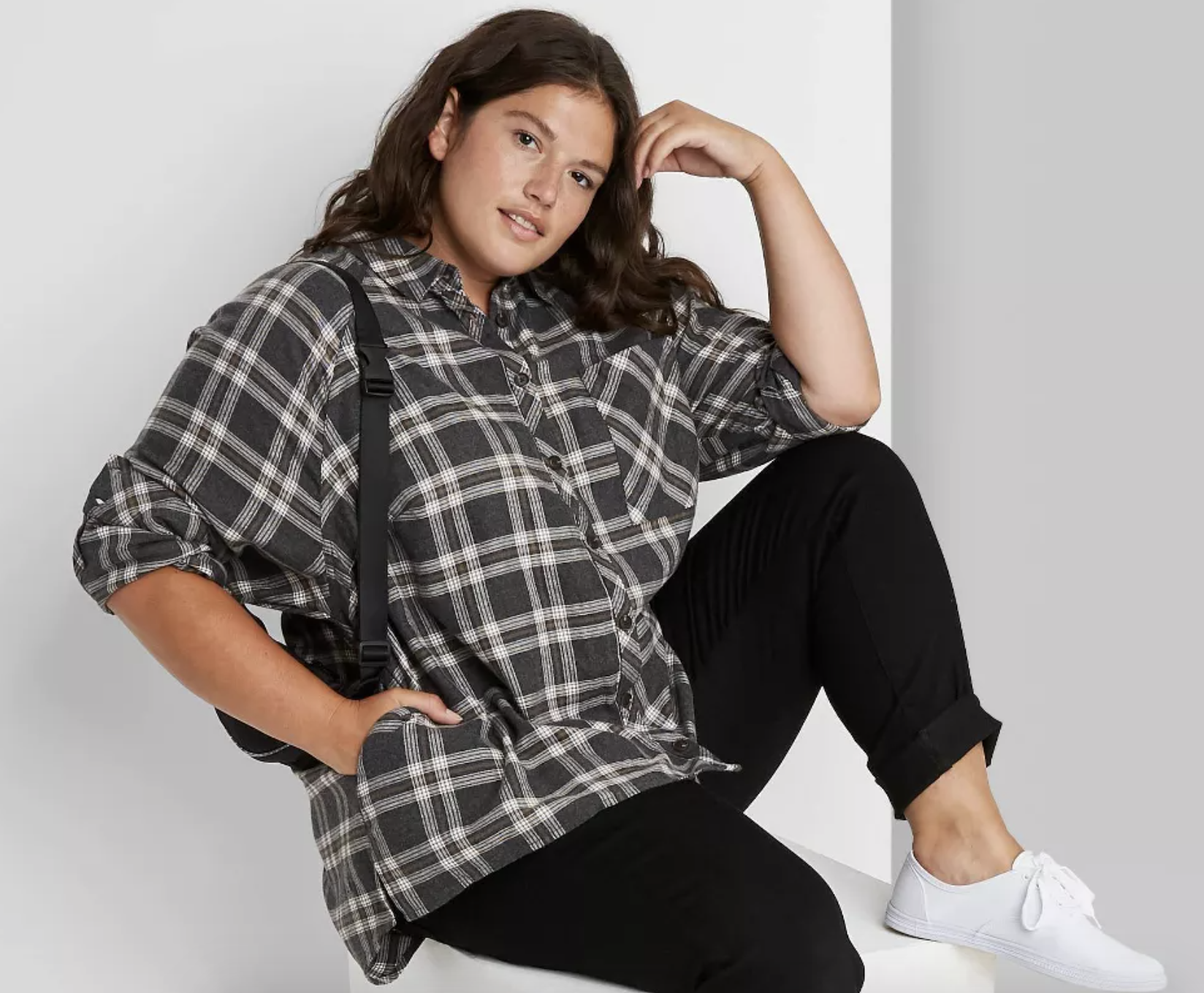 model wearing gray and white plaid shirt