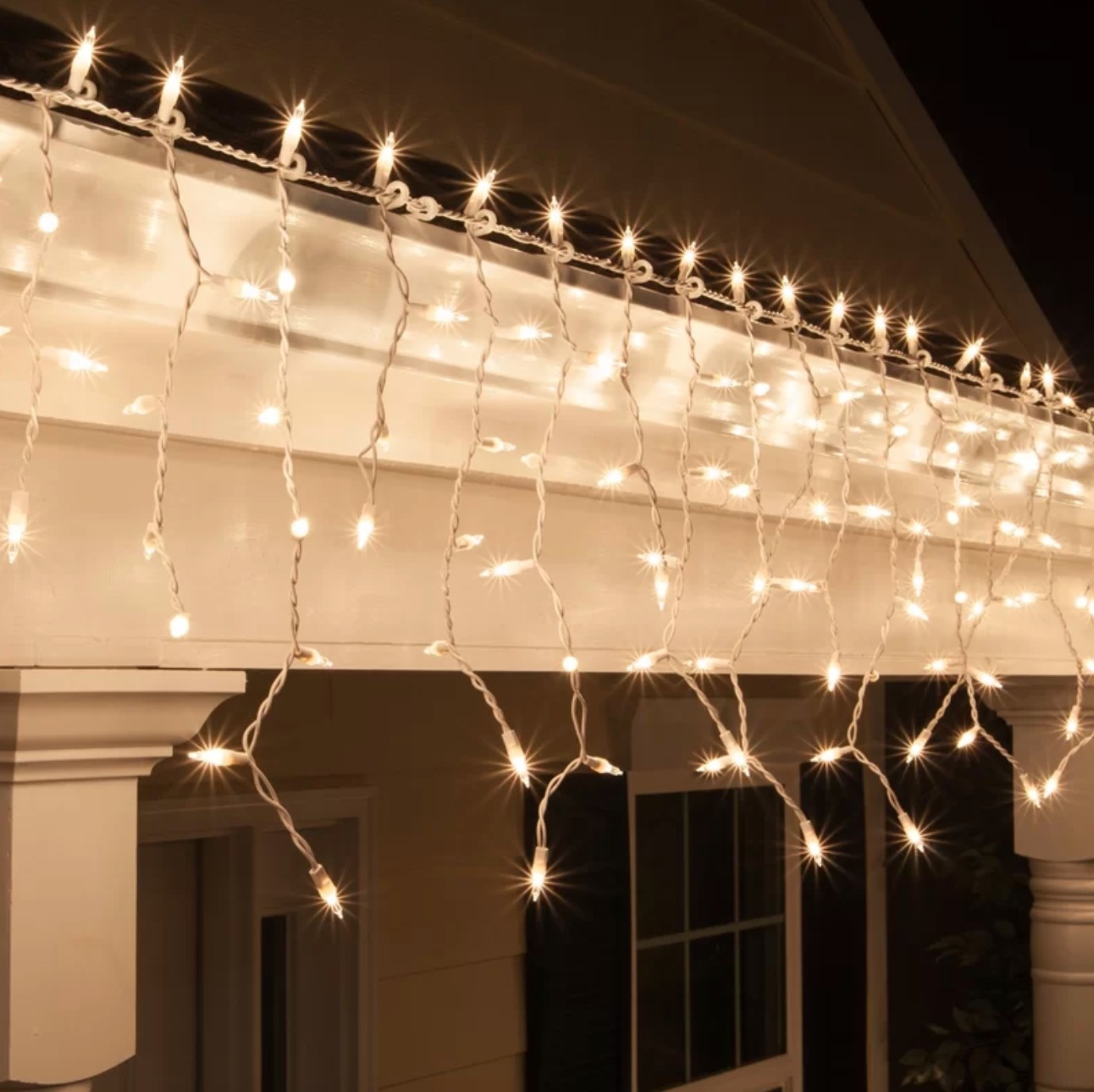 The set of 100 icicle lights in clear creating a relaxed ambiance