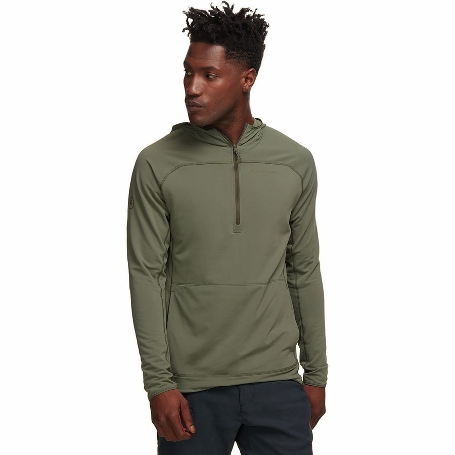 a model wearing the hooded pullover in olive color