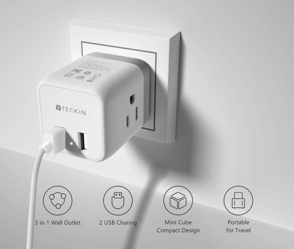 An outlet splitter plugged into a wall with various charging options