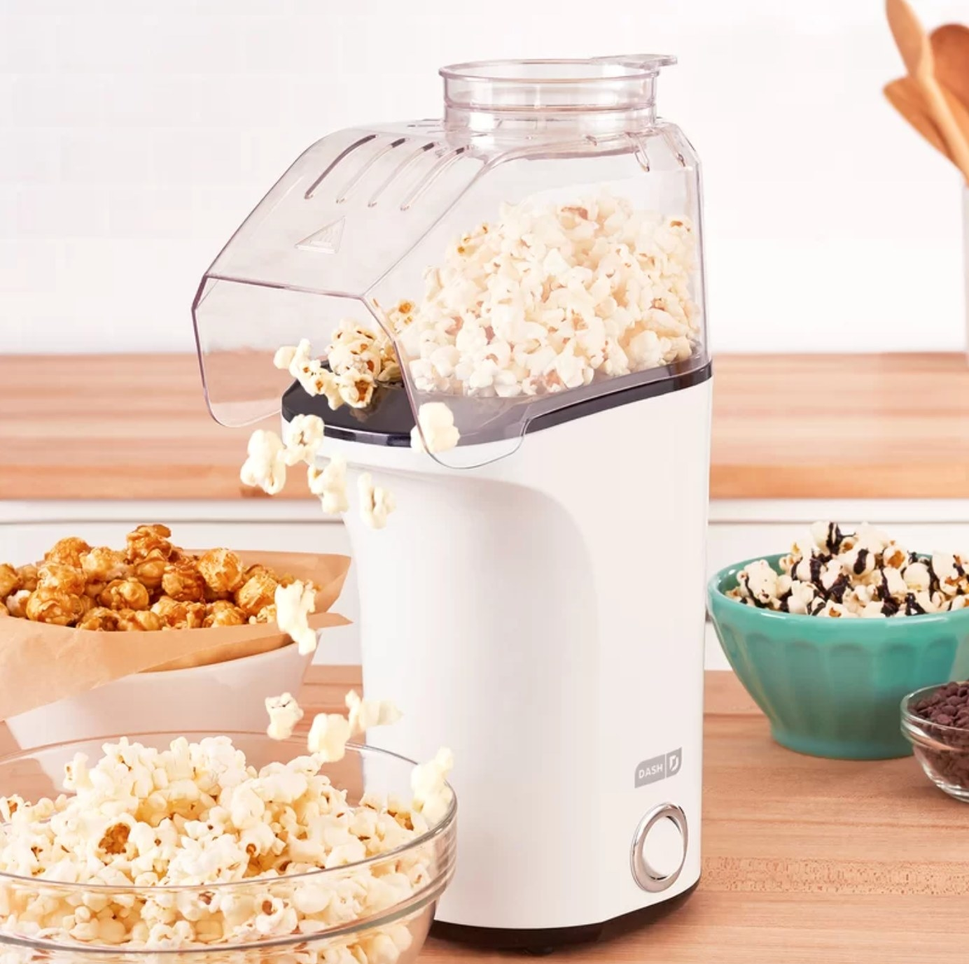 The hot air popcorn popper in white using hot air to pop the kernels