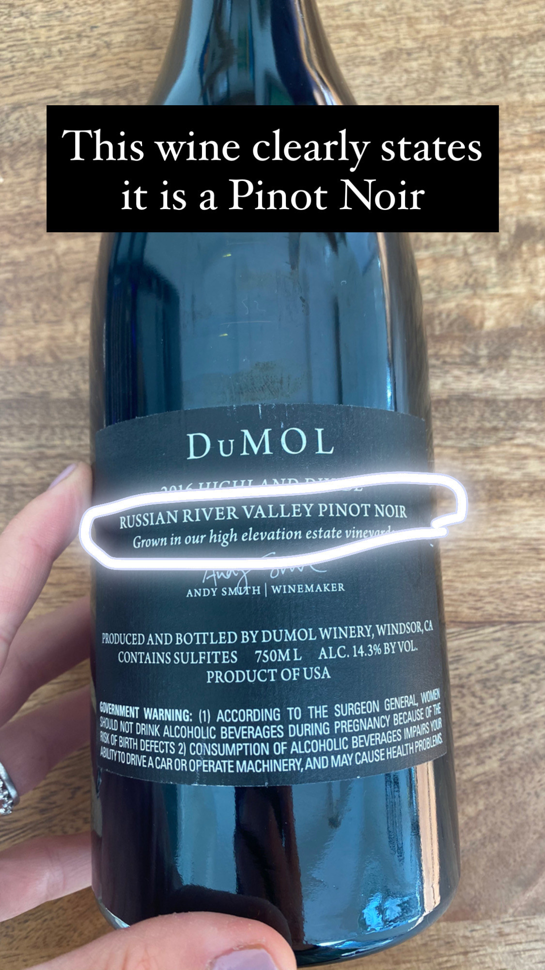 The back of a Dumol wine label, showing where the wine is grown and the variety.