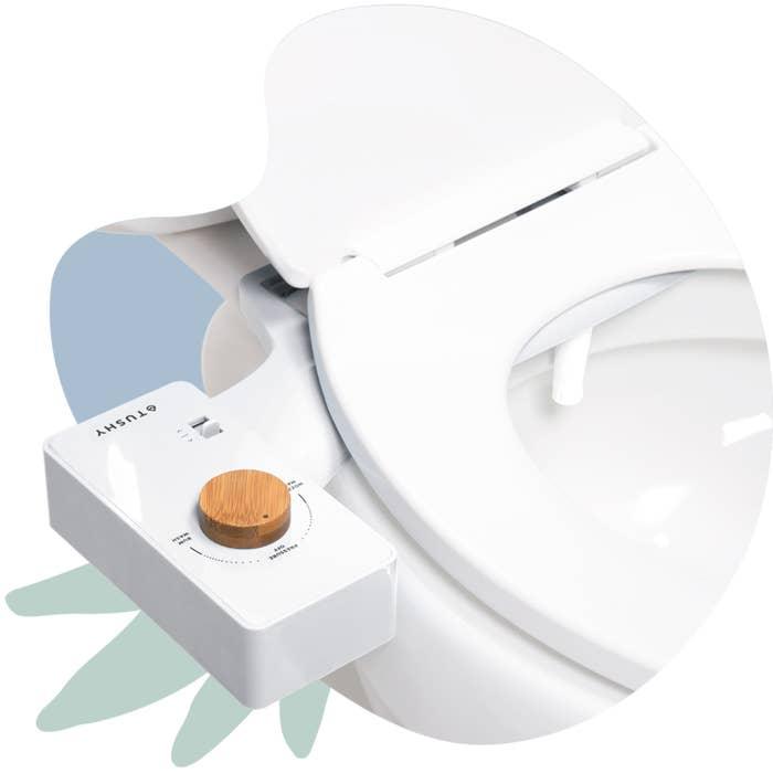 A white bidet attachment on a white toilet