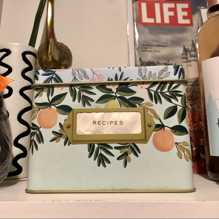the buzzfeed editor's mint green recipe tin with fruit and leaves on itq