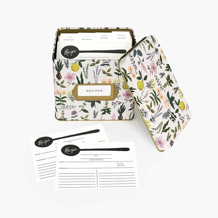 the light pink recipe box with delicate florals on it and two recipe cards