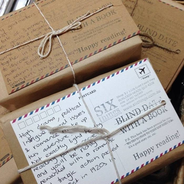 Book in brown paper and twine with postcard detailing theme of book inside