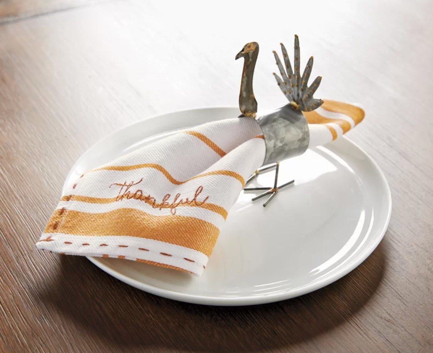 The set of four Thanksgiving-inspired napkins in white and orange