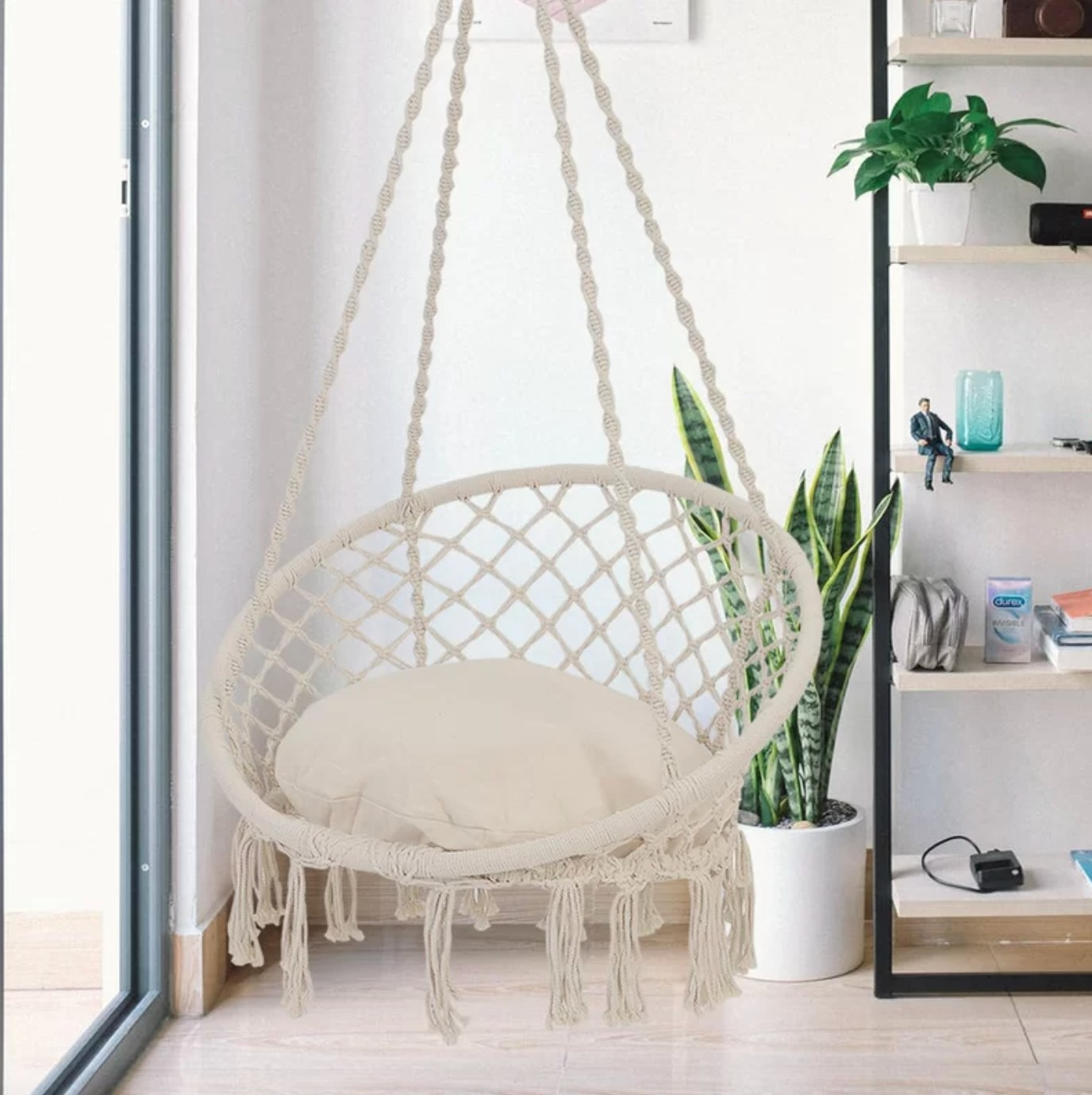 The hanging hammock chair in beige with a comfy pillow
