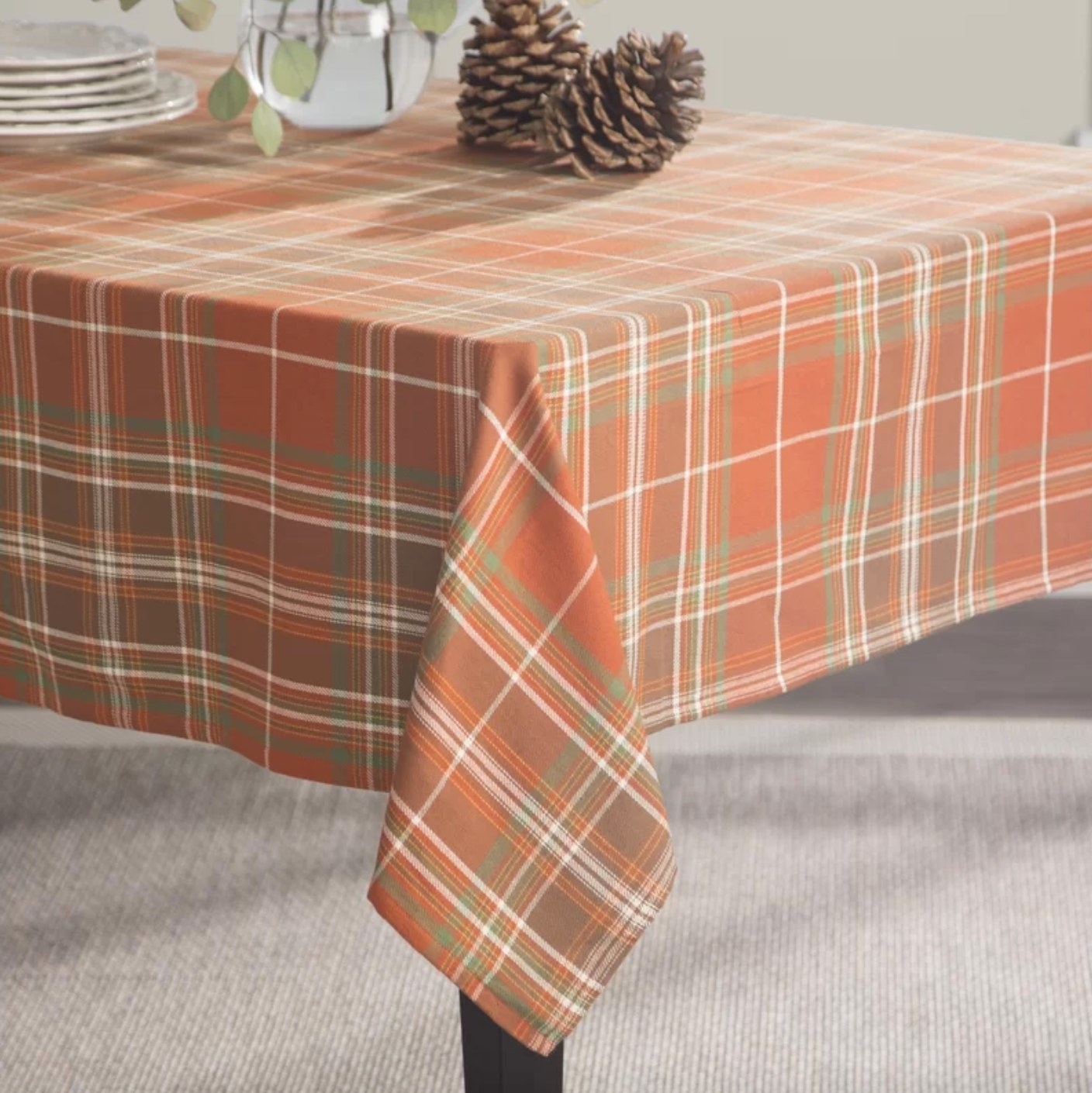 The plaid tablecloth in orange, green, and white