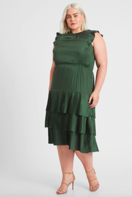 the dress in green worn by a model