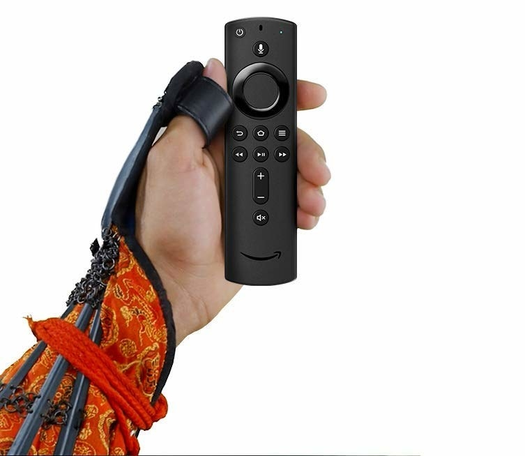 A hand holding the remote