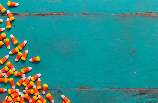 Candy corn across brightly-colored wood
