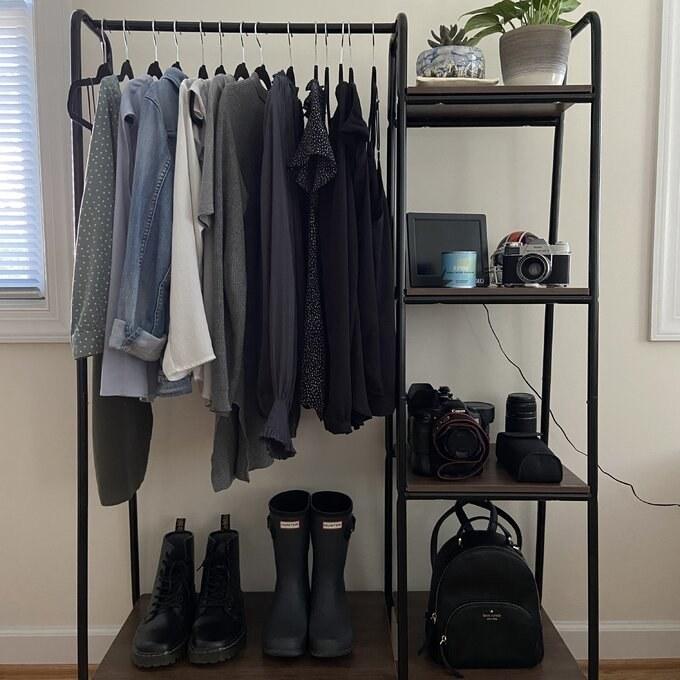 The black/dark brown garment rack