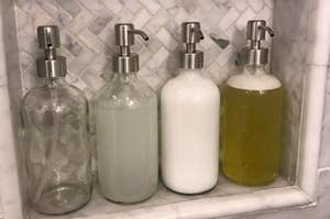 row of shower products in stainless steel handsoap pumps