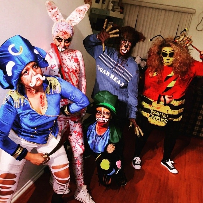 Five people dressed as cereal mascots, covered in blood
