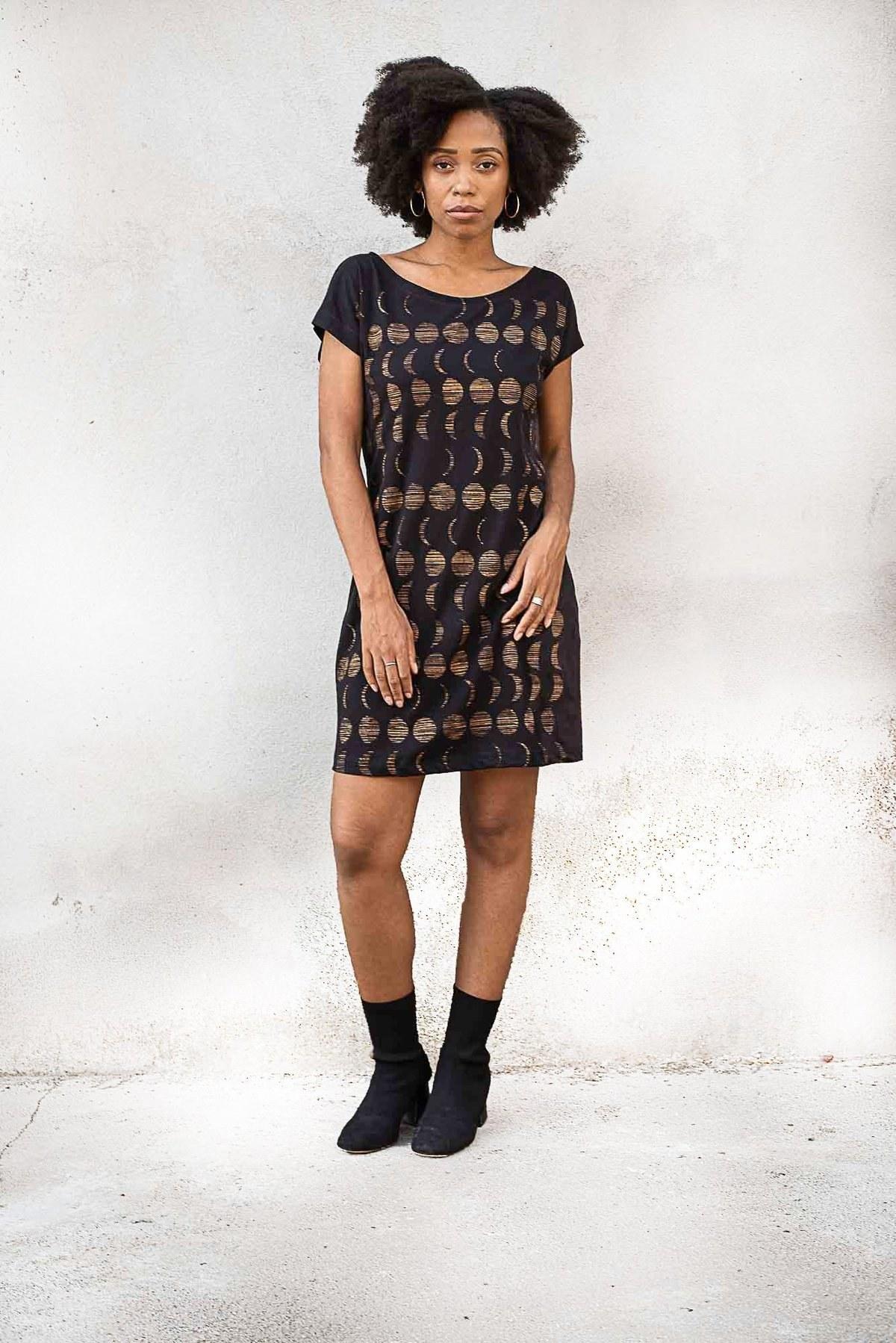 model wearing black mini t-shirt dress