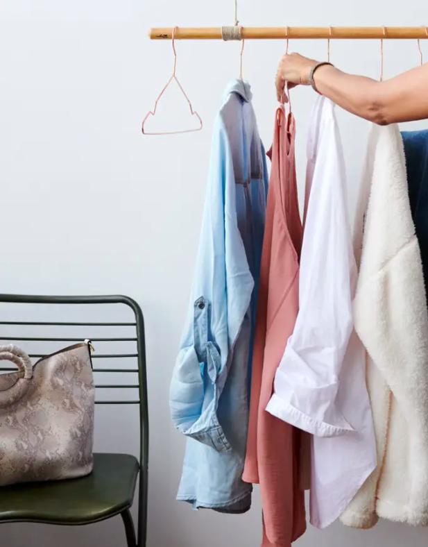 shirts and a jacket hanging on a wardrobe