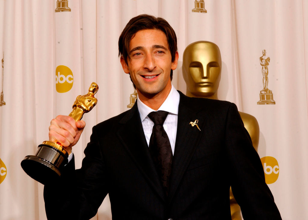 Adrian holding up his Oscar