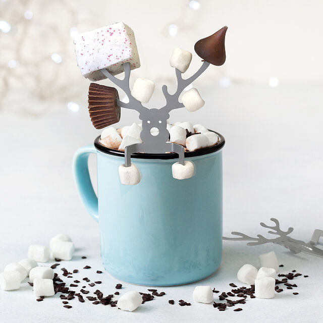 the caribou in a mug with marshmallows, Hershey's kisses, and mini Reese's on the prongs of its antlers