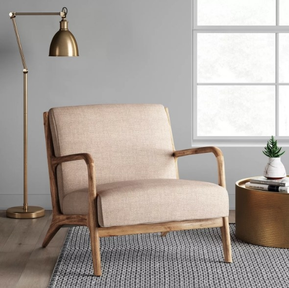 Armchair and gold floor lamp