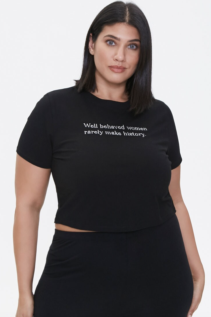 a model in a black tee that says well behaved women rarely make history in white
