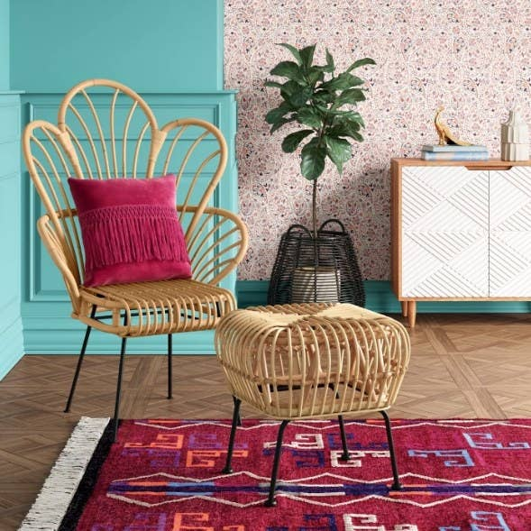 Fan back chair with stool and pink rug