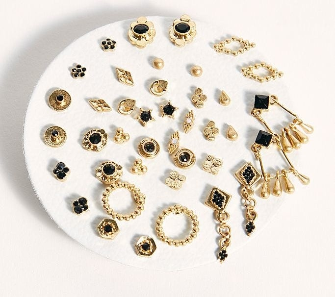 The set of gold tone and black earrings in a variety of shapes and sizes