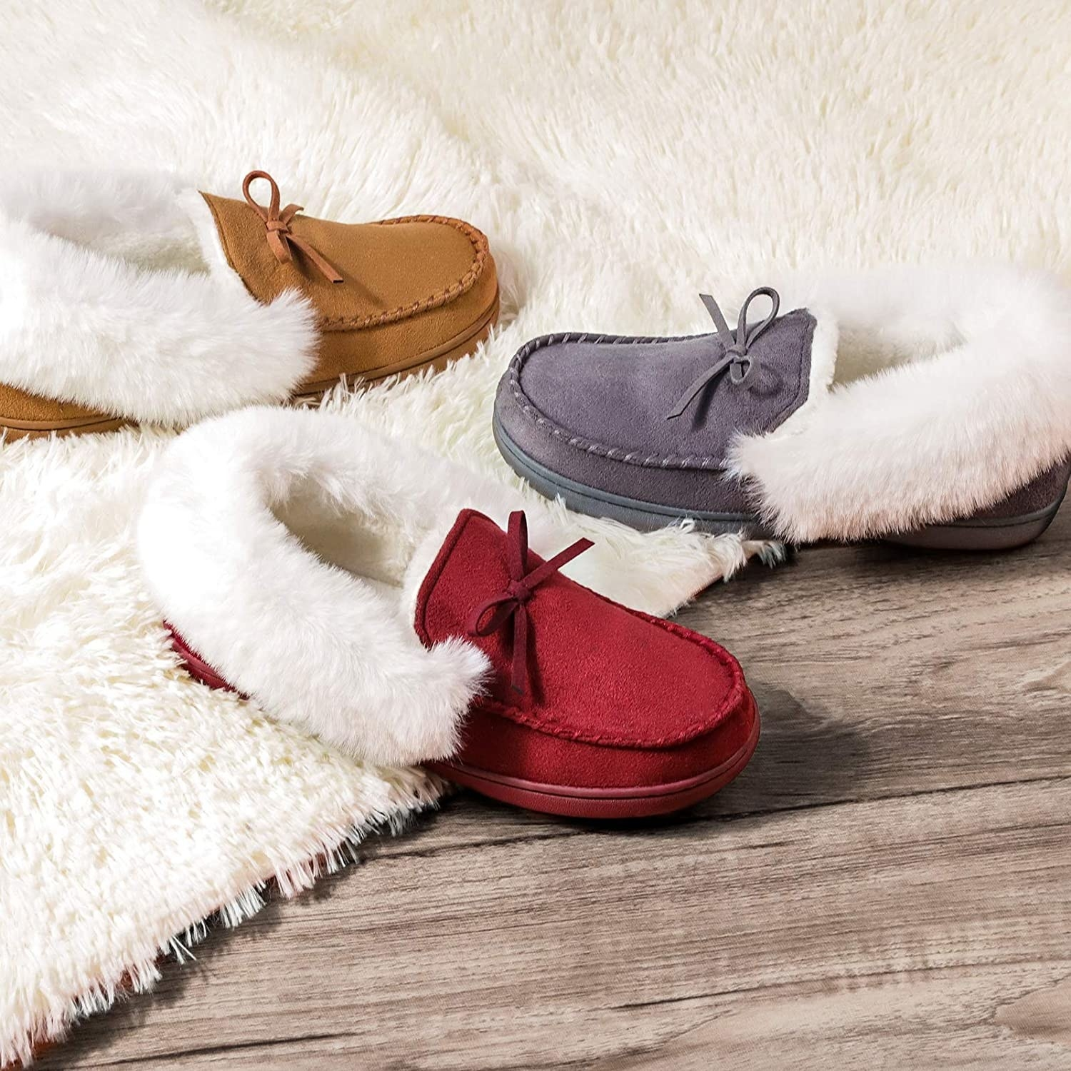 The loafer slippers in red, grey, and camel
