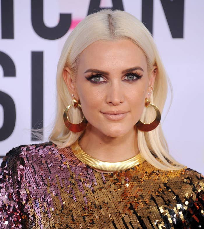 Ashlee Simpson in a sequin dress and hoop earrings