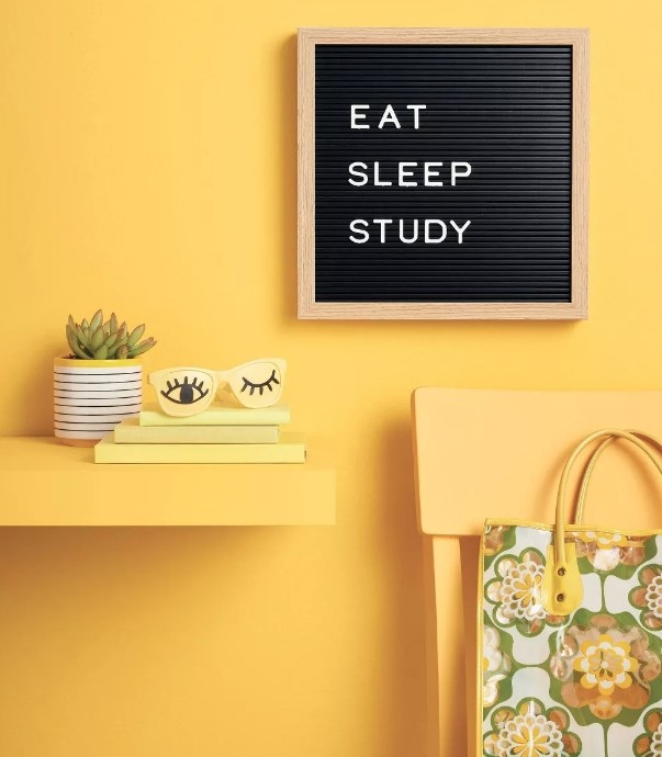 Letterboard on yellow wall