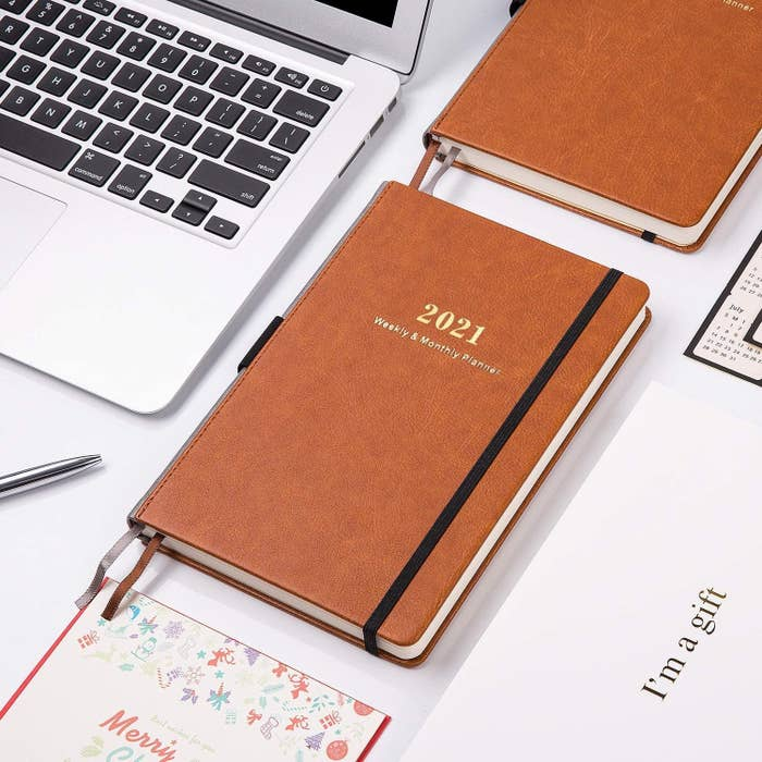 The brown planner with gold foil year stamp