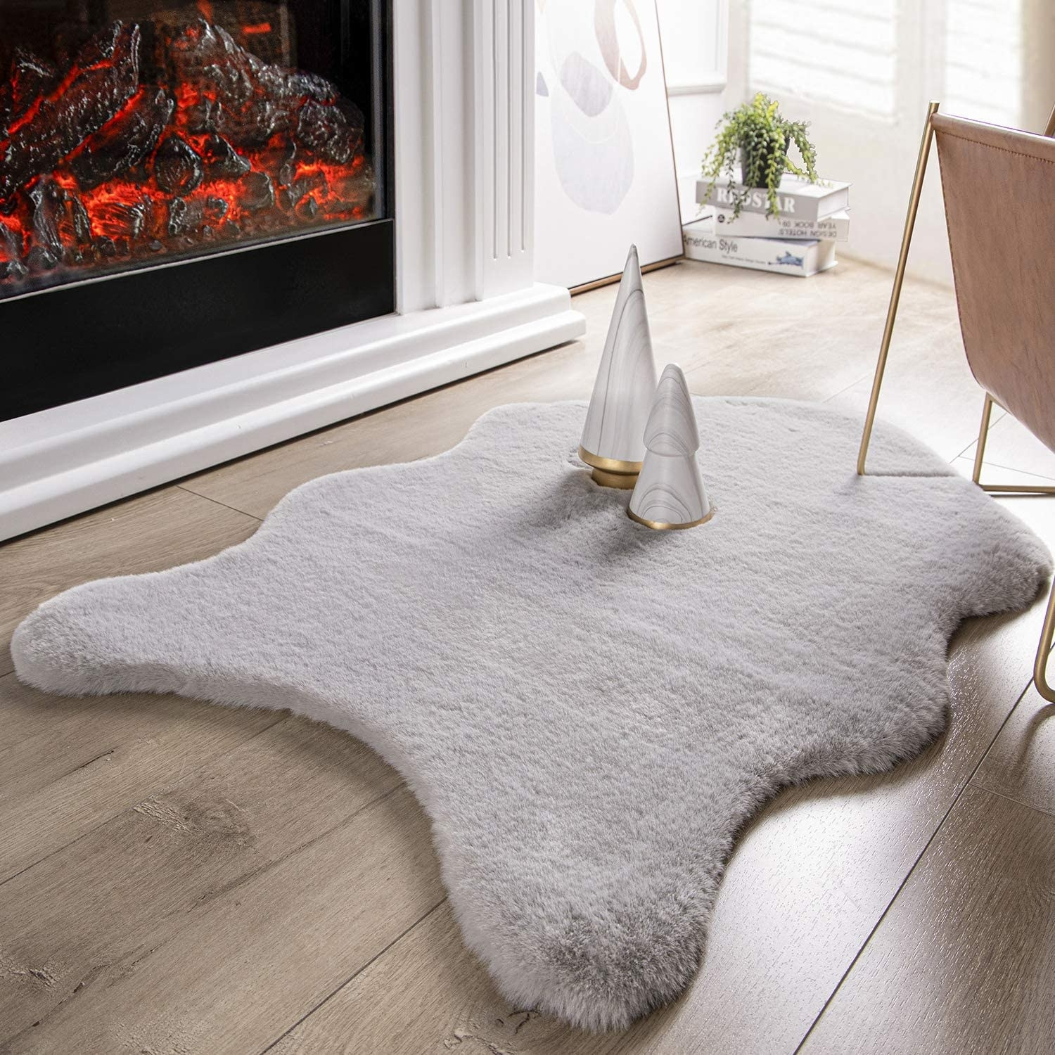The curved edge (like a pelt) rug in white