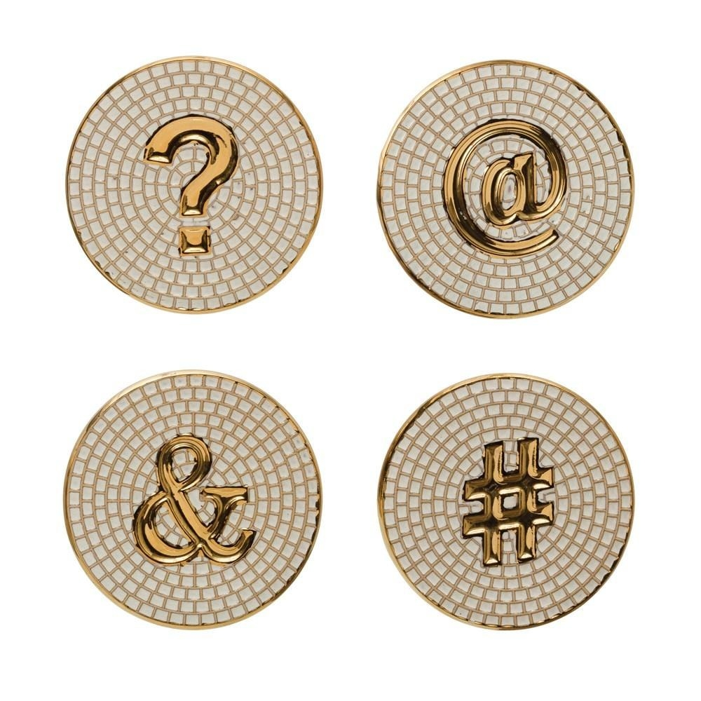The coasters that look like small white tile mosaics, with a question mark, at-sign, ampersand, and hashtag in the middle of each