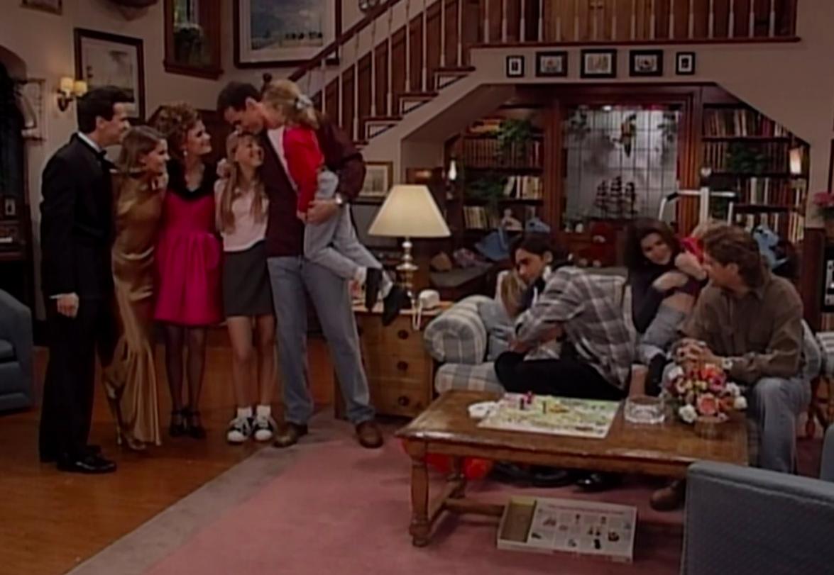A still of Steve, D.J., Kimmy, Stephanie, Danny, Michelle, Jesse, Becky, Joey, Nicky, and Alex in Full House