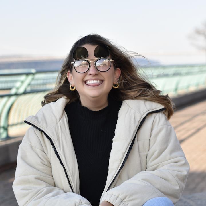 BuzzFeed staff writer Allison Faccenda wears Amavii Altair sunglasses in black