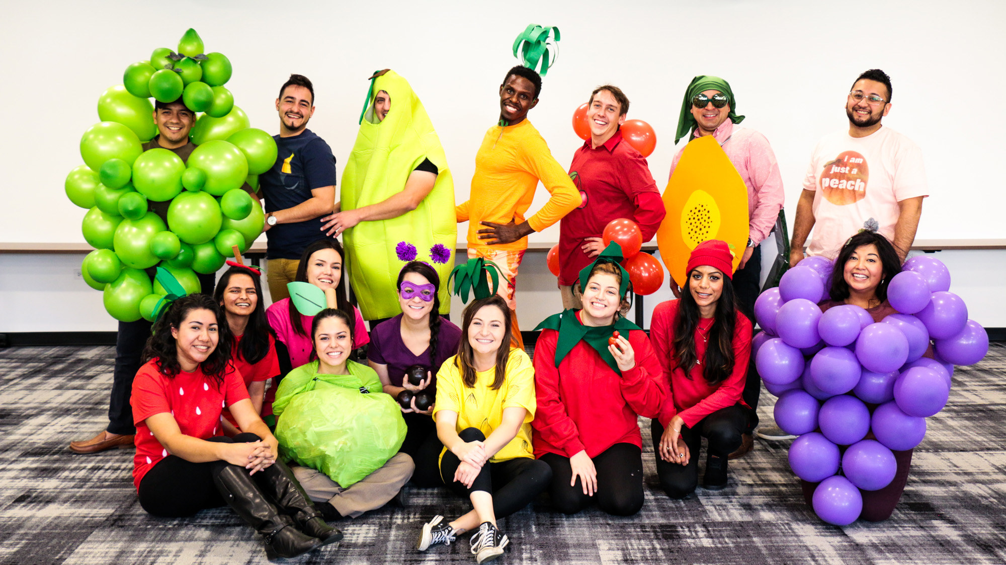 PacMan universe at the firm with people dressed as fruit