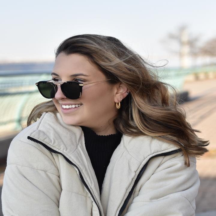 BuzzFeed staff writer Allison Faccenda wearing Amavii Altair sunglasses in black