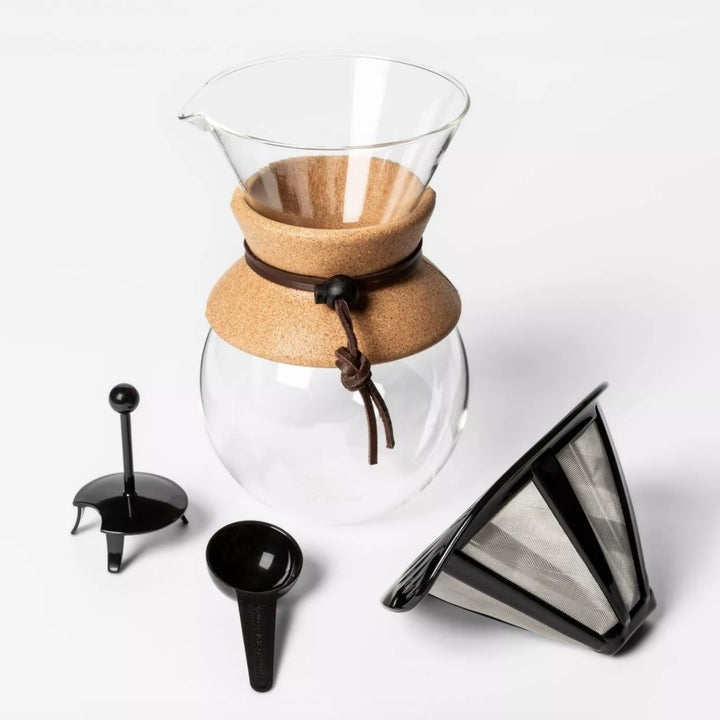 A glass pour over coffee maker with filter and scoop