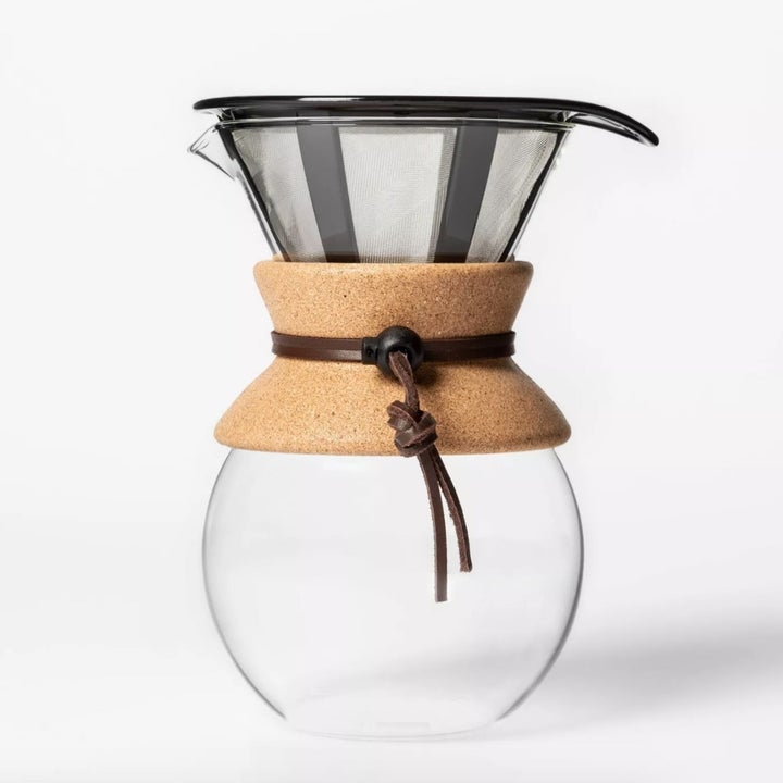 A glass pour over coffee maker with filter