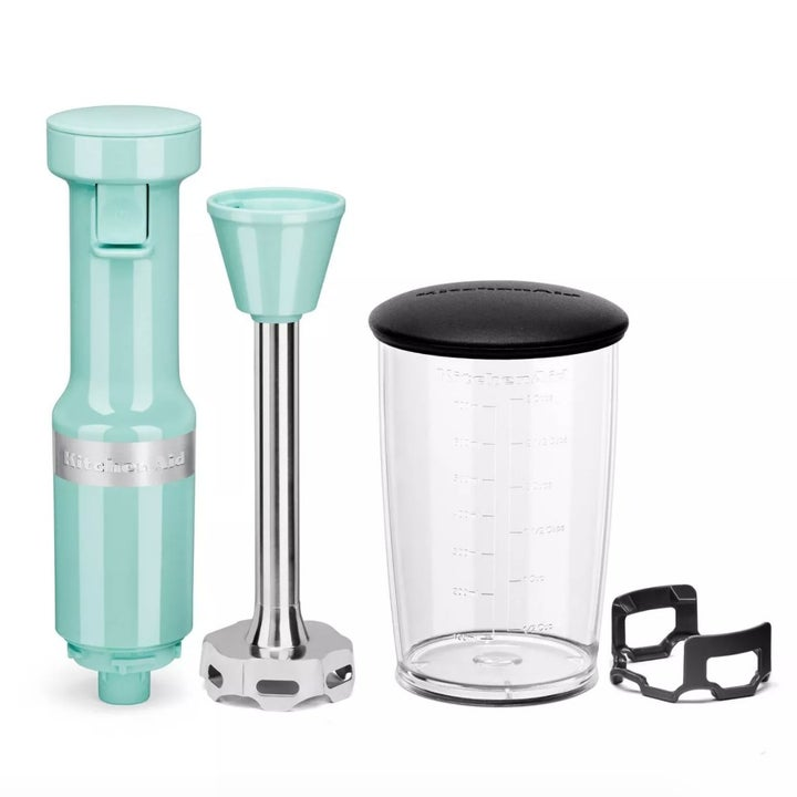 A turquoise blue immersion blender with plastic blending cup