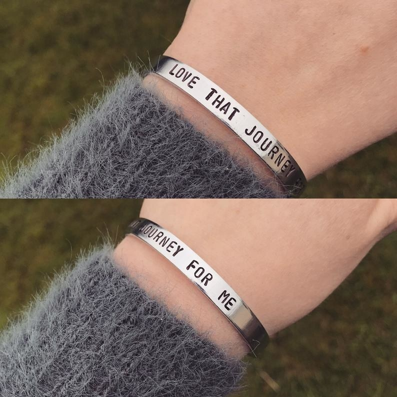 A person wearing the bangle with a fuzzy sweater