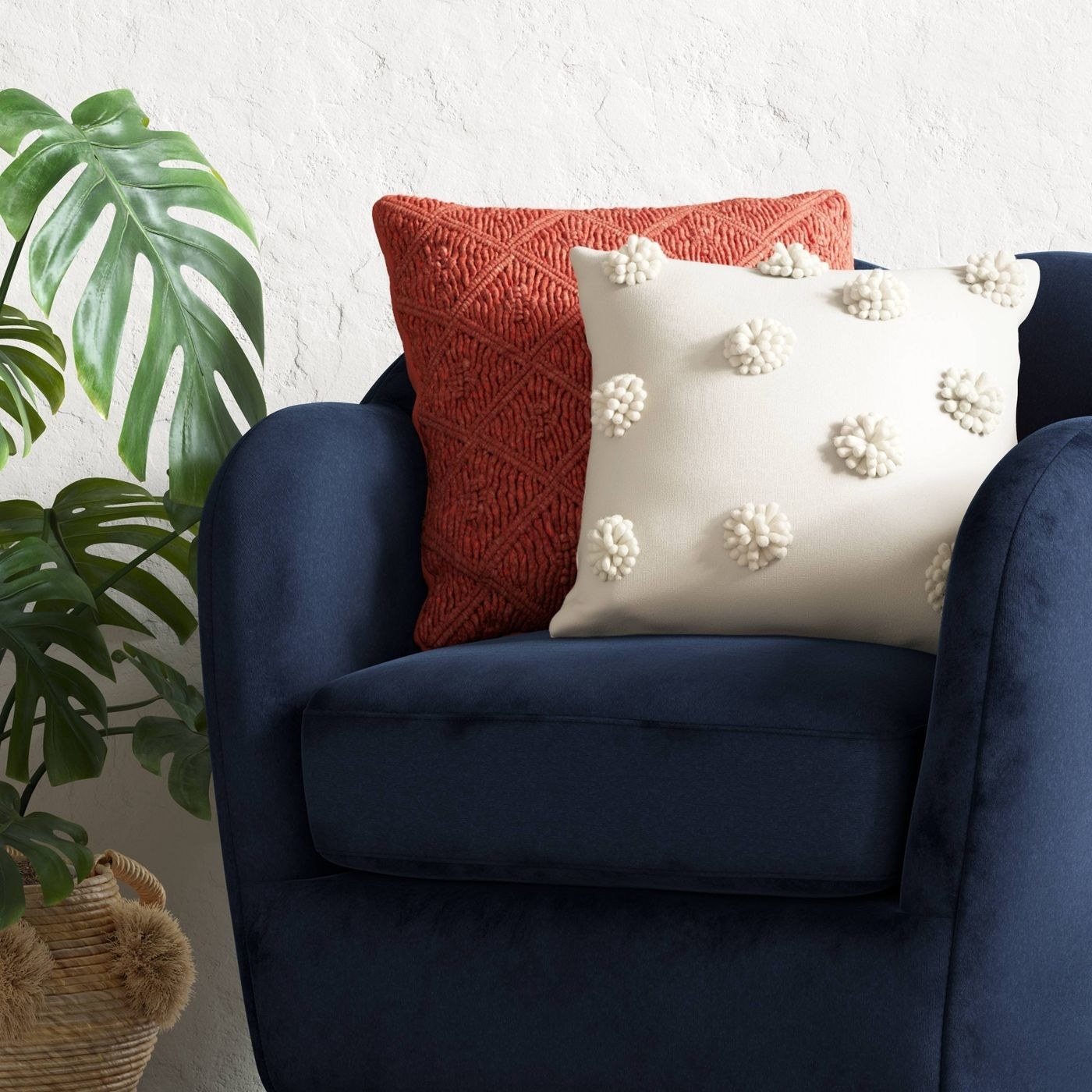 Pom-pom throw pillow on couch