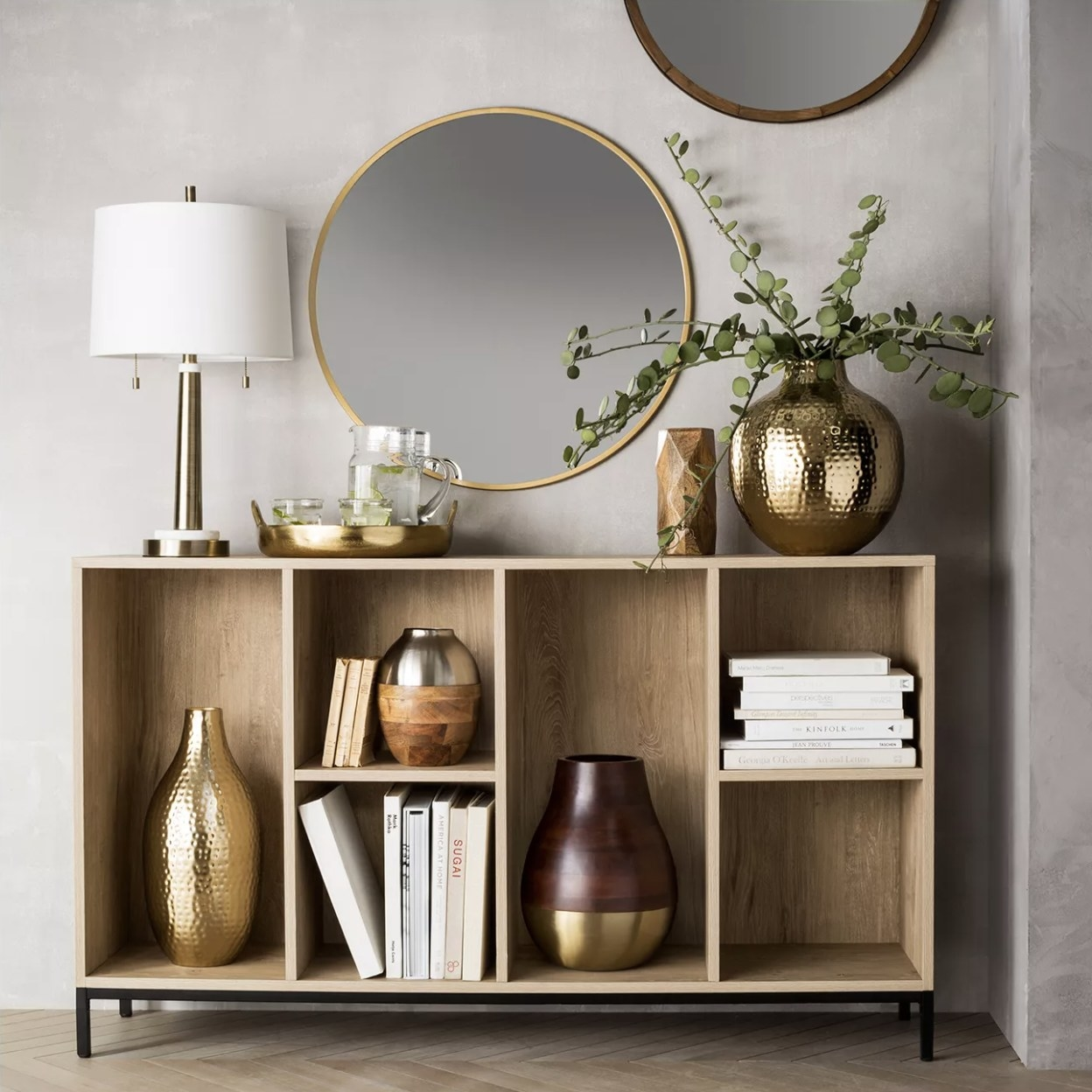 The gold frame circle mirror hung on a wall